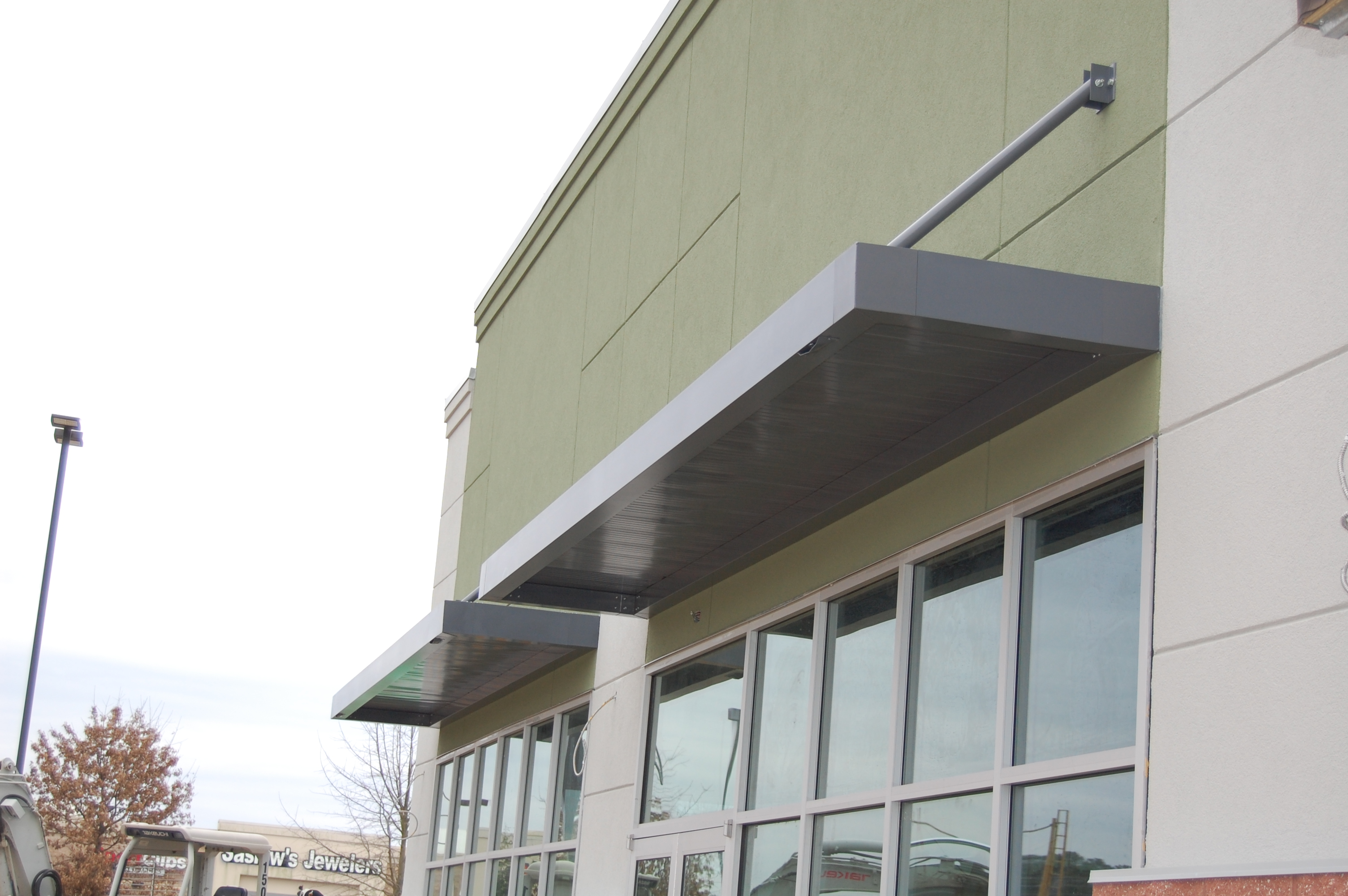 extruded aluminum canopies - csc awnings inc.